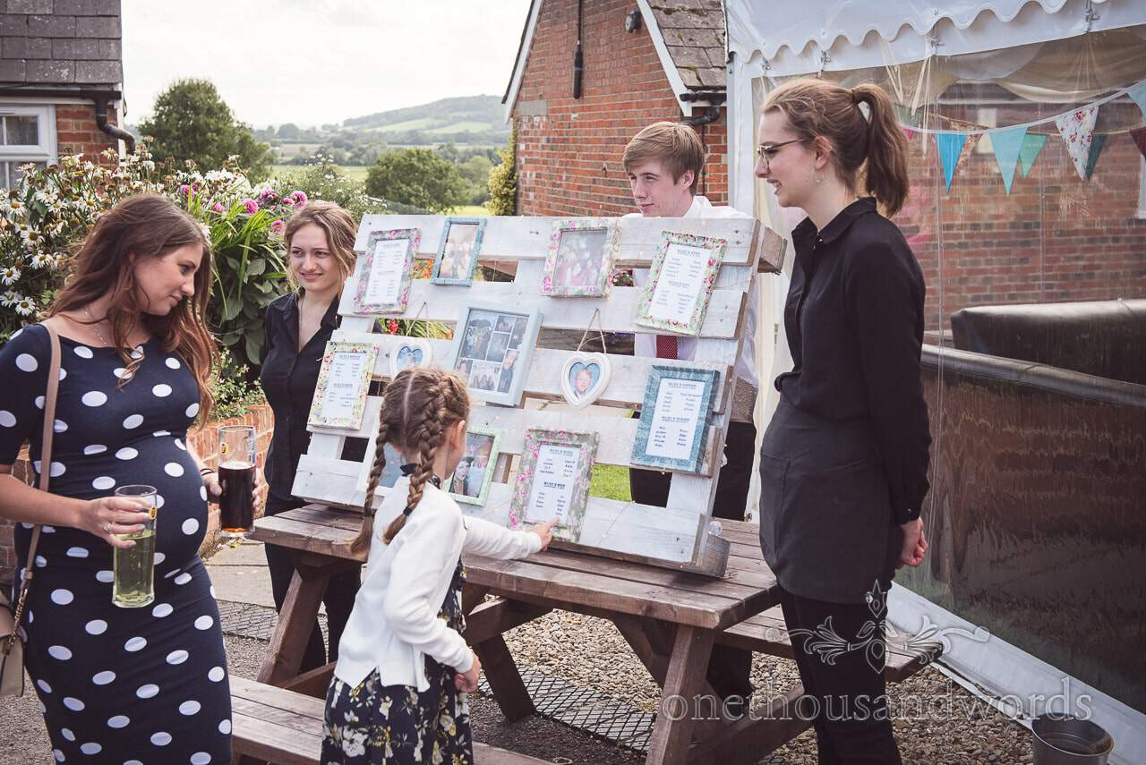 Guests find themselves on home maid pallet table plan Coppleridge Inn Wedding Photographs