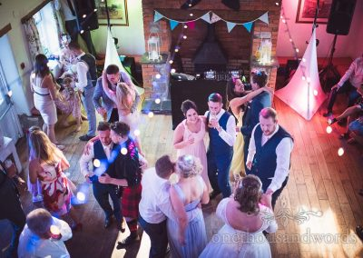Guests join bride and groom on dance floor at Coppleridge Inn Wedding Photographs