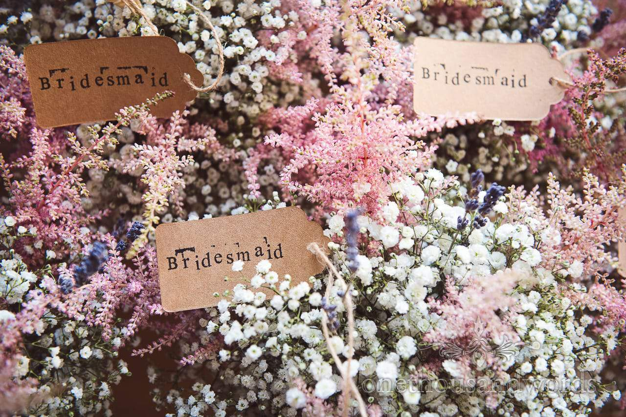 Gypsophila and wild flower bridesmaid bouquets with stamped card labels