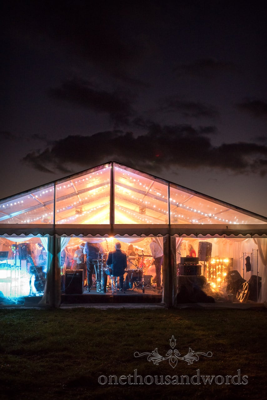 Illuminated Marquee against night sky at Purbeck Valley Farm Wedding