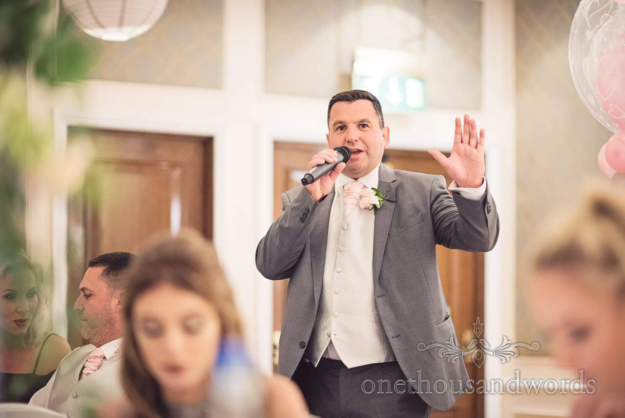 Master of ceremonies announces speeches at Bournemouth Highcliff Marriott wedding