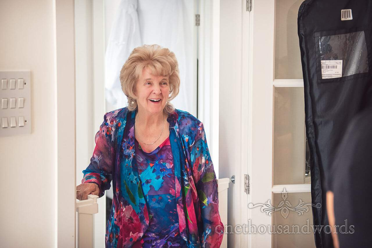 Mother of the bride laughing during wedding morning bridal preparations