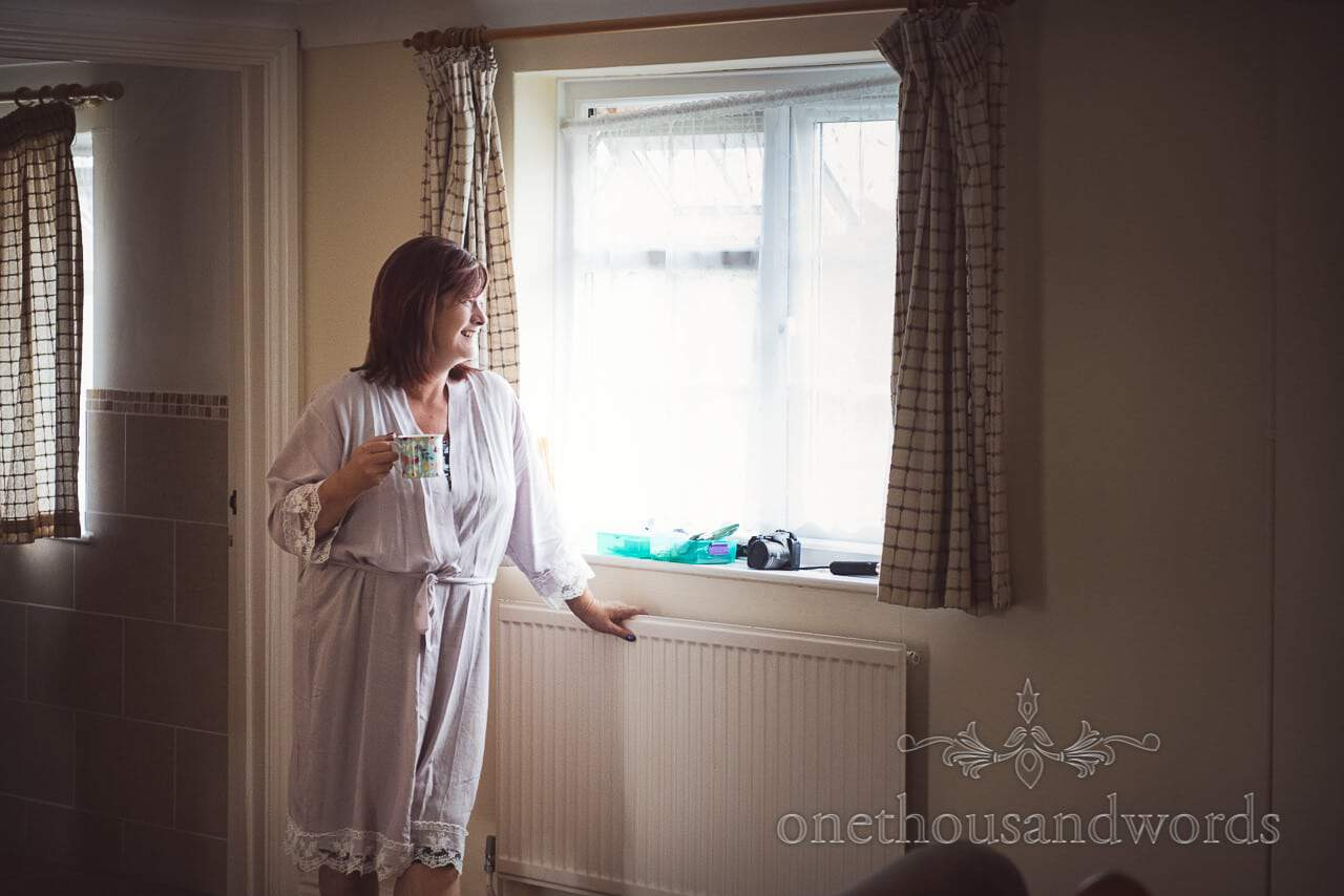Mother of the bride look out window at Coppleridge Inn Wedding Photographs