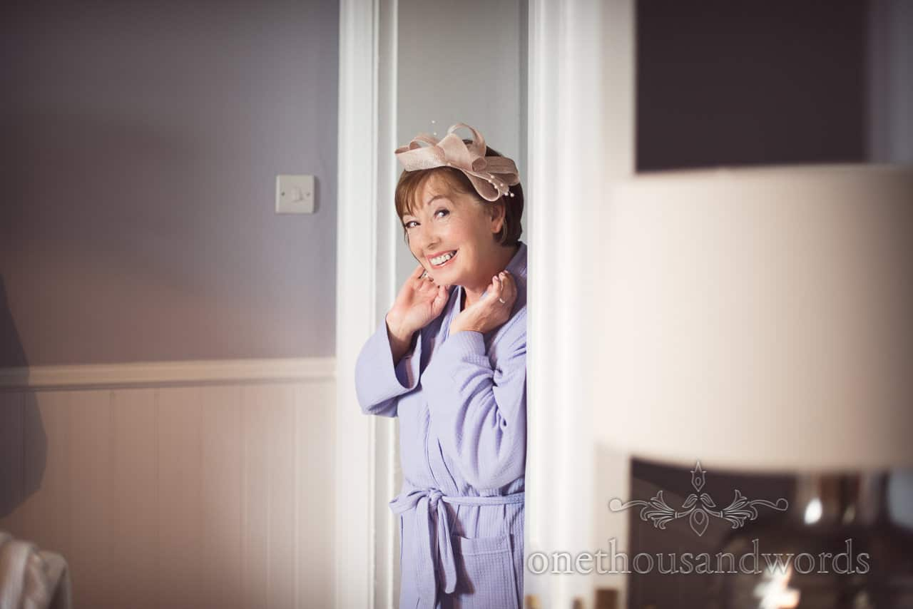 Mother of the bride shows off wedding fascinator on wedding morning in Dorset