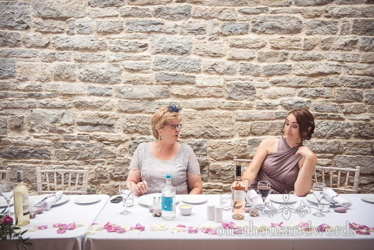 Mother of the groom and bridesmaid pull funny faces at Durlston Castle Wedding Breakfast