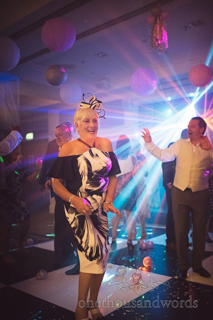 Mother of the groom dances on Bournemouth Highcliff Marriott wedding dance floor
