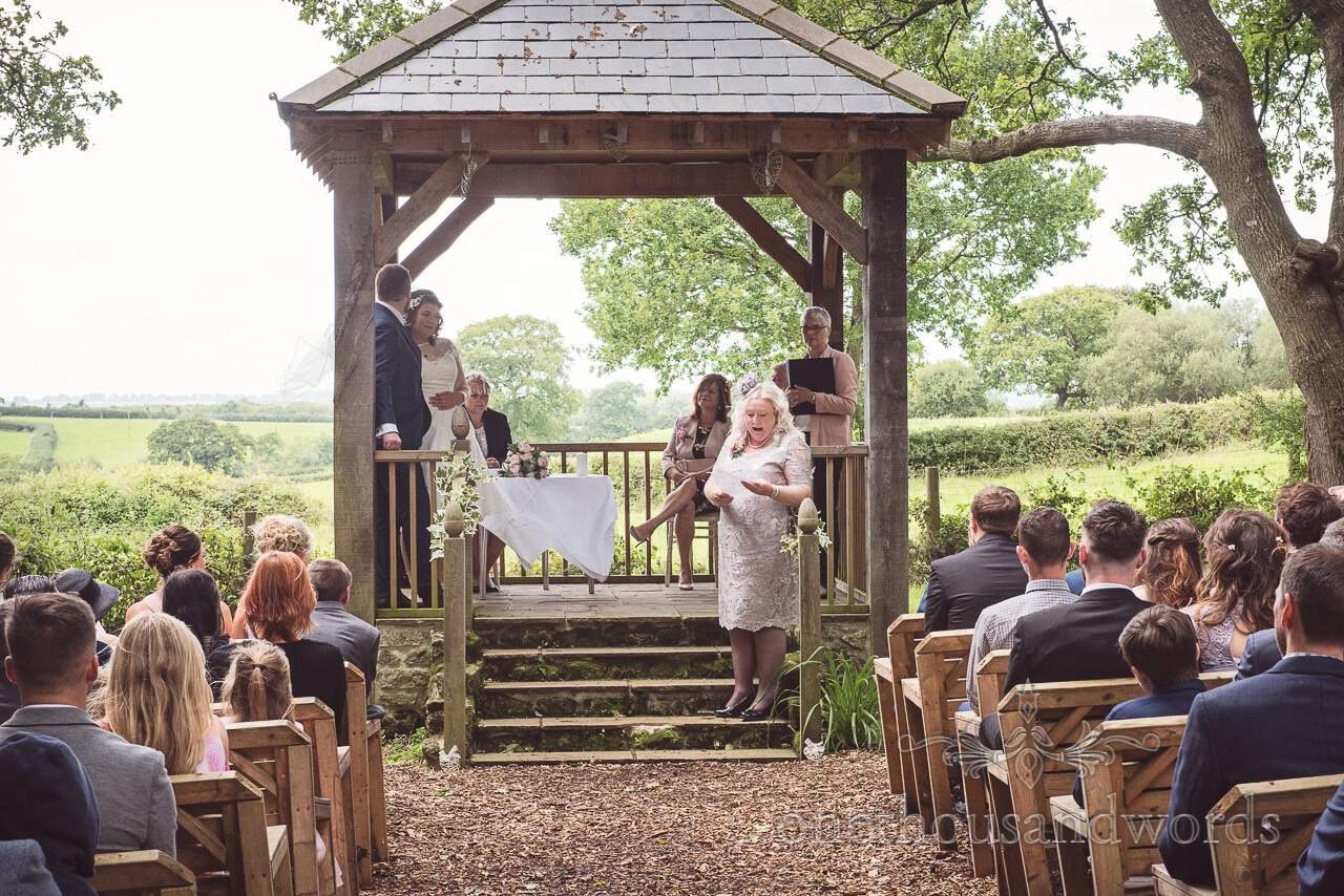 Mother of the groom delivers reading at woodland ceremony at Coppleridge Inn