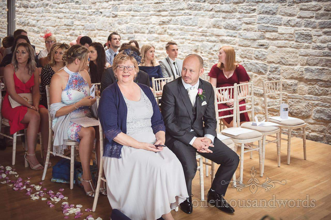 Mother of the groom laughing at Durlston Castle Wedding ceremony