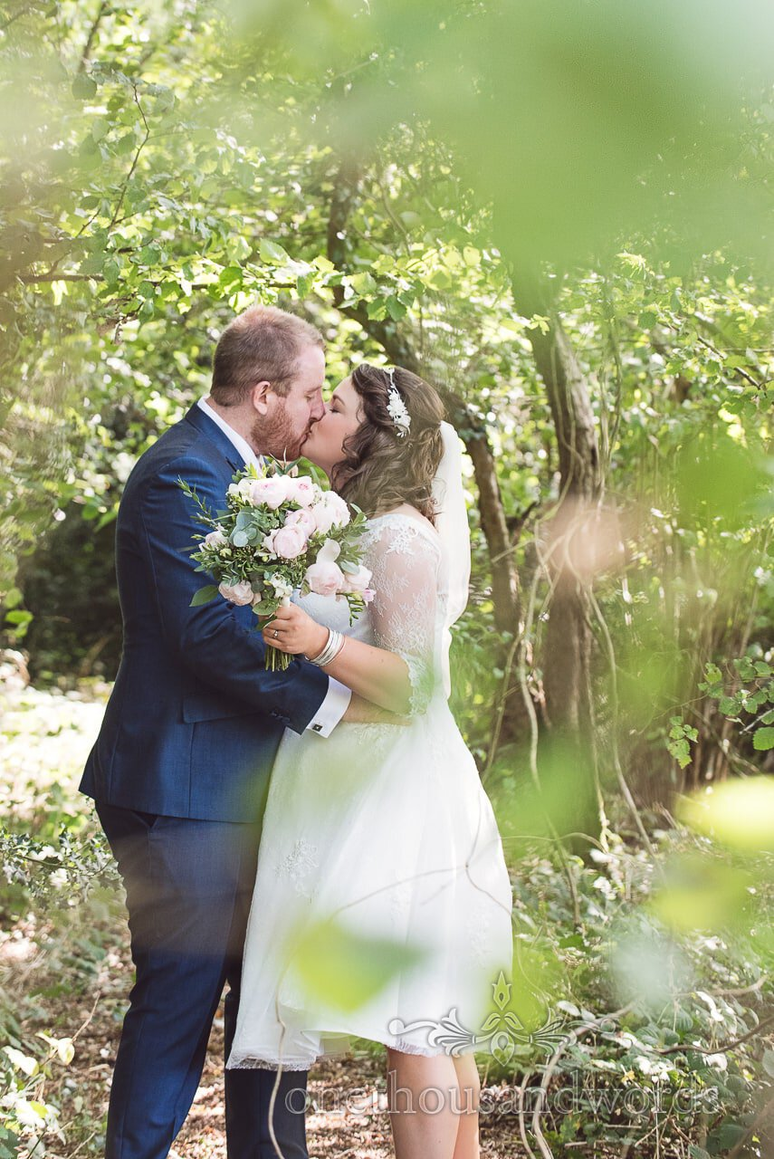 New Mr and Mrs kiss in the woods at Coppleridge Inn Wedding Photographs