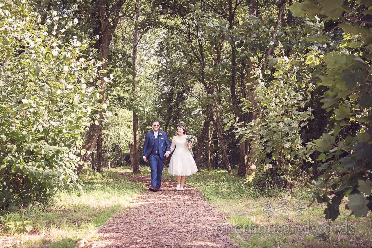 New Mr and Mrs walk in the woods at Coppleridge Inn Wedding Photographs