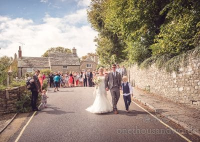 Newlyweds and son after ceremony at Worth Matravers