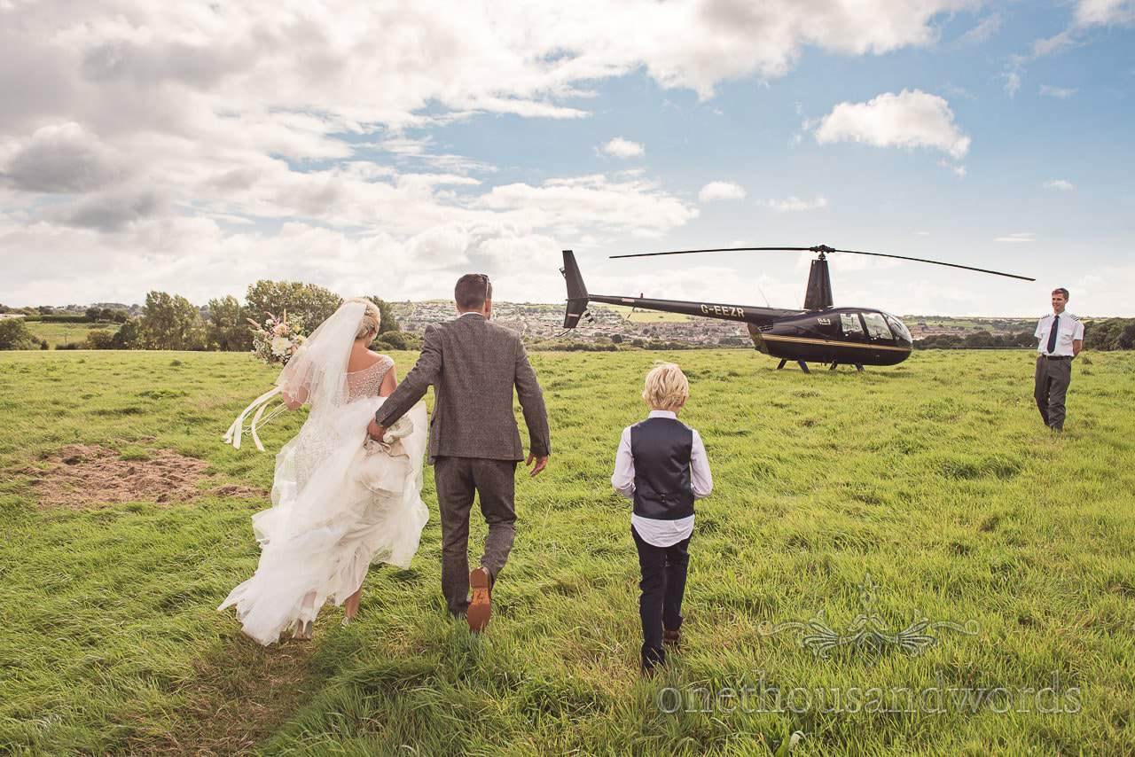 Newlyweds and son arrive to travel to reception venue Purbeck Valley Farm