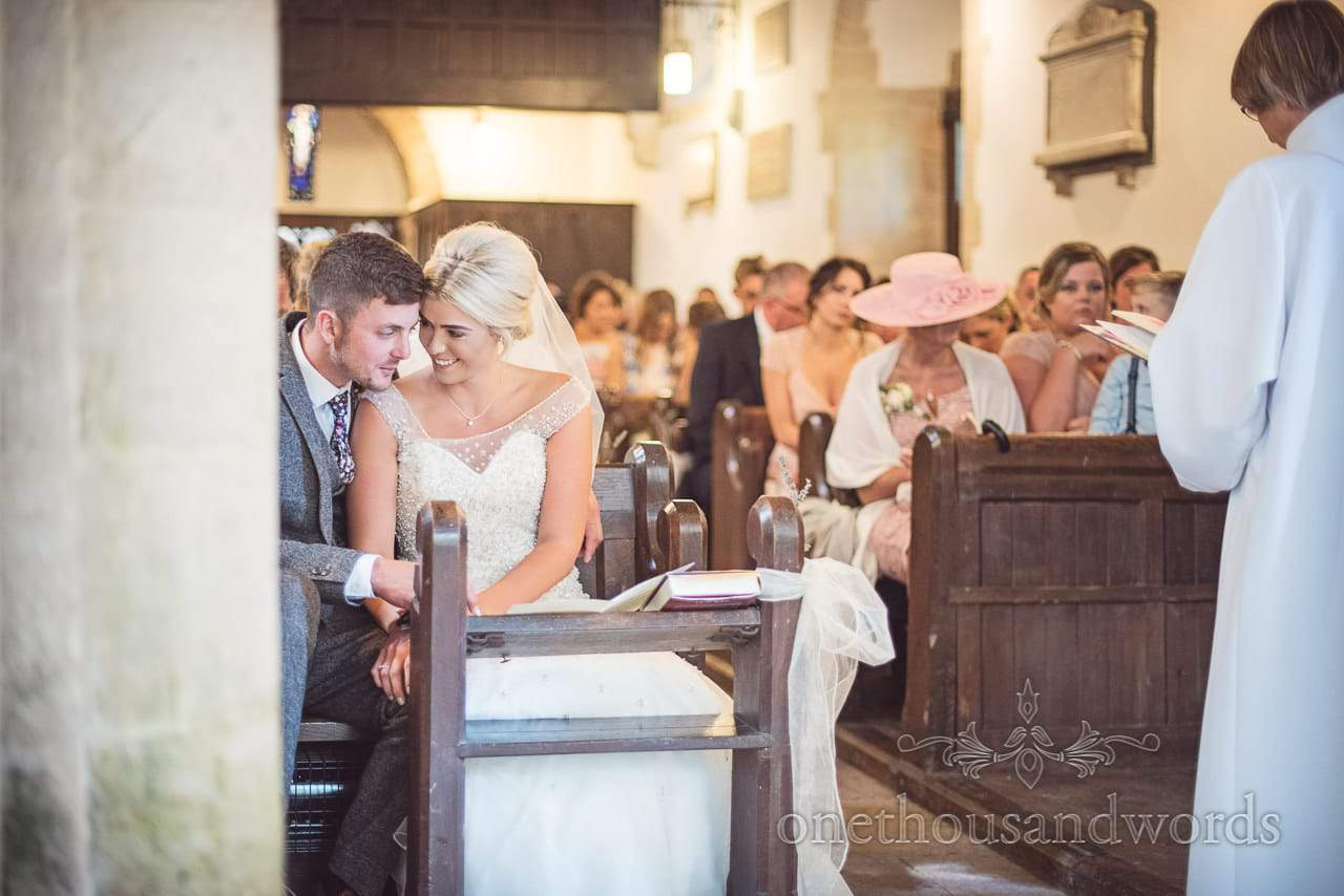 Newlyweds share a moment in worth Matravers church