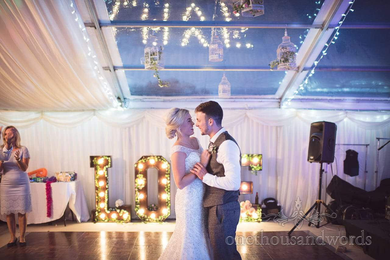 Newlyweds take there first dance as husband and wife at Purbeck Valley Farm wedding photographs