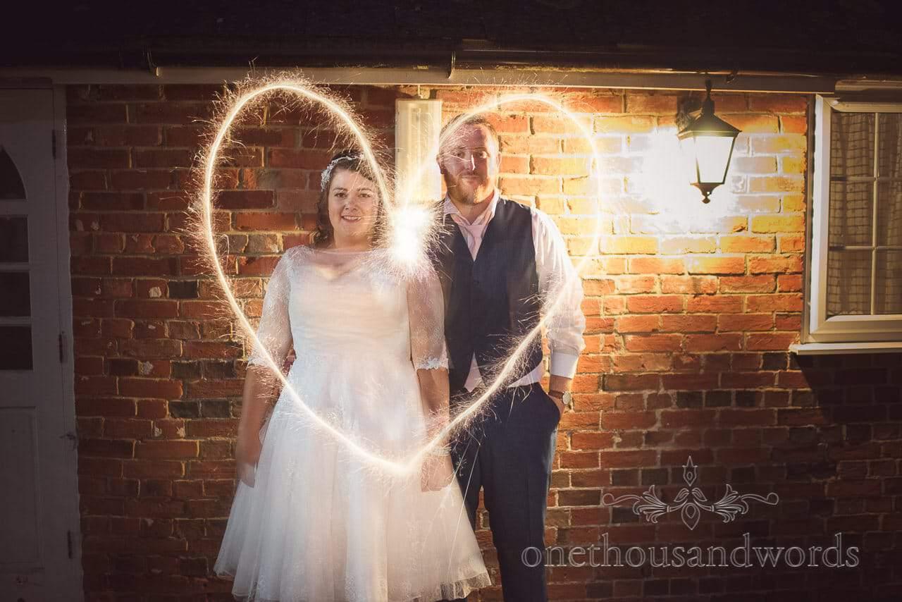 Newlyweds with sparkler heart at Coppleridge Inn Wedding Photographs