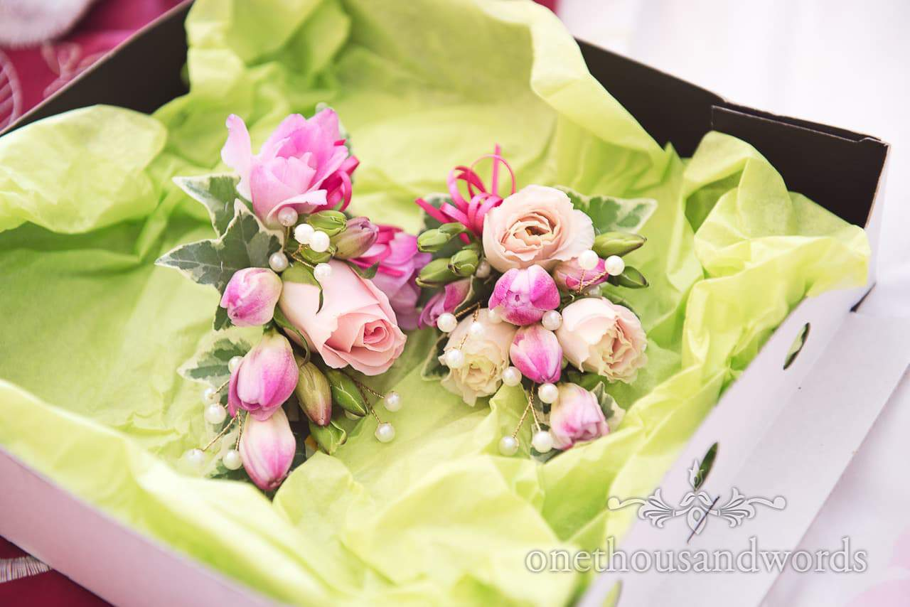 Pink and pastel wedding corsages in box from Coppleridge Inn Wedding Photographs