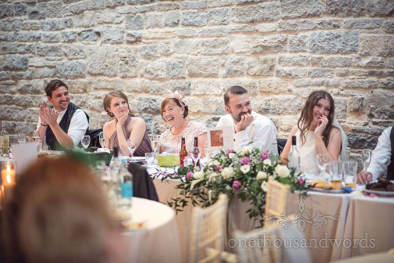 Top table react to wedding speeches at Durlston Castle Wedding Photographs