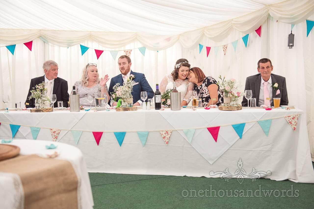 Top table reaction during best mens speech Coppleridge Inn Wedding Photographs