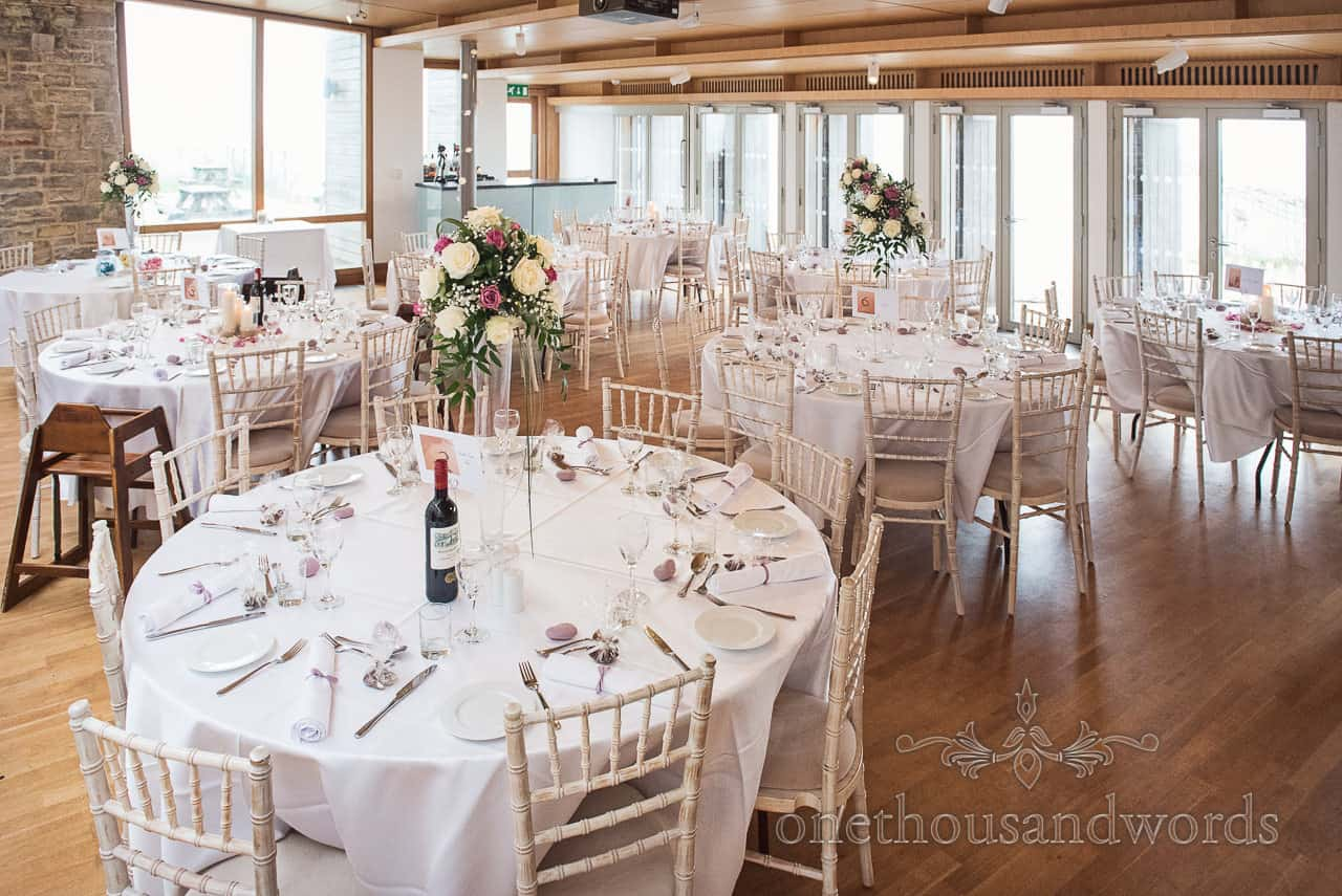 Wedding breakfast layout in the Gallery at Durlston Castle Wedding Venue by the sea