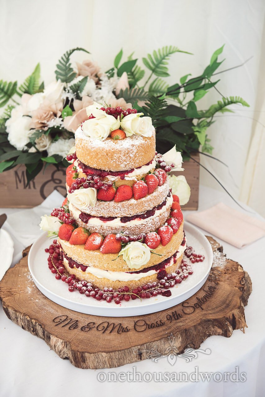 Wedding cake on personalised wooded base Purbeck Valley Farm wedding photographs