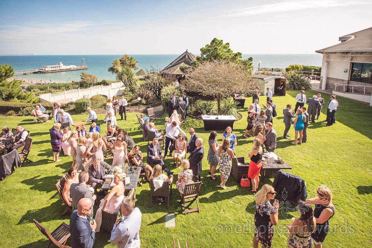 Wedding drinks reception on lawns overlooking Bournemouth Pier and beach at Highcliffe Marriott
