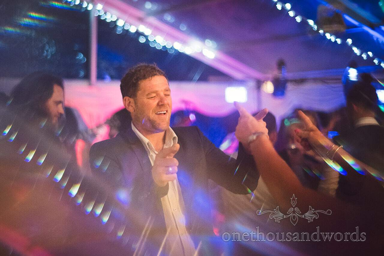 Wedding guest getting down at Purbeck Valley Farm Wedding photographs