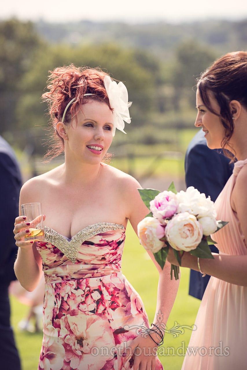 Wedding guest in floral dress during drinks reception at Coppleridge Inn Wedding
