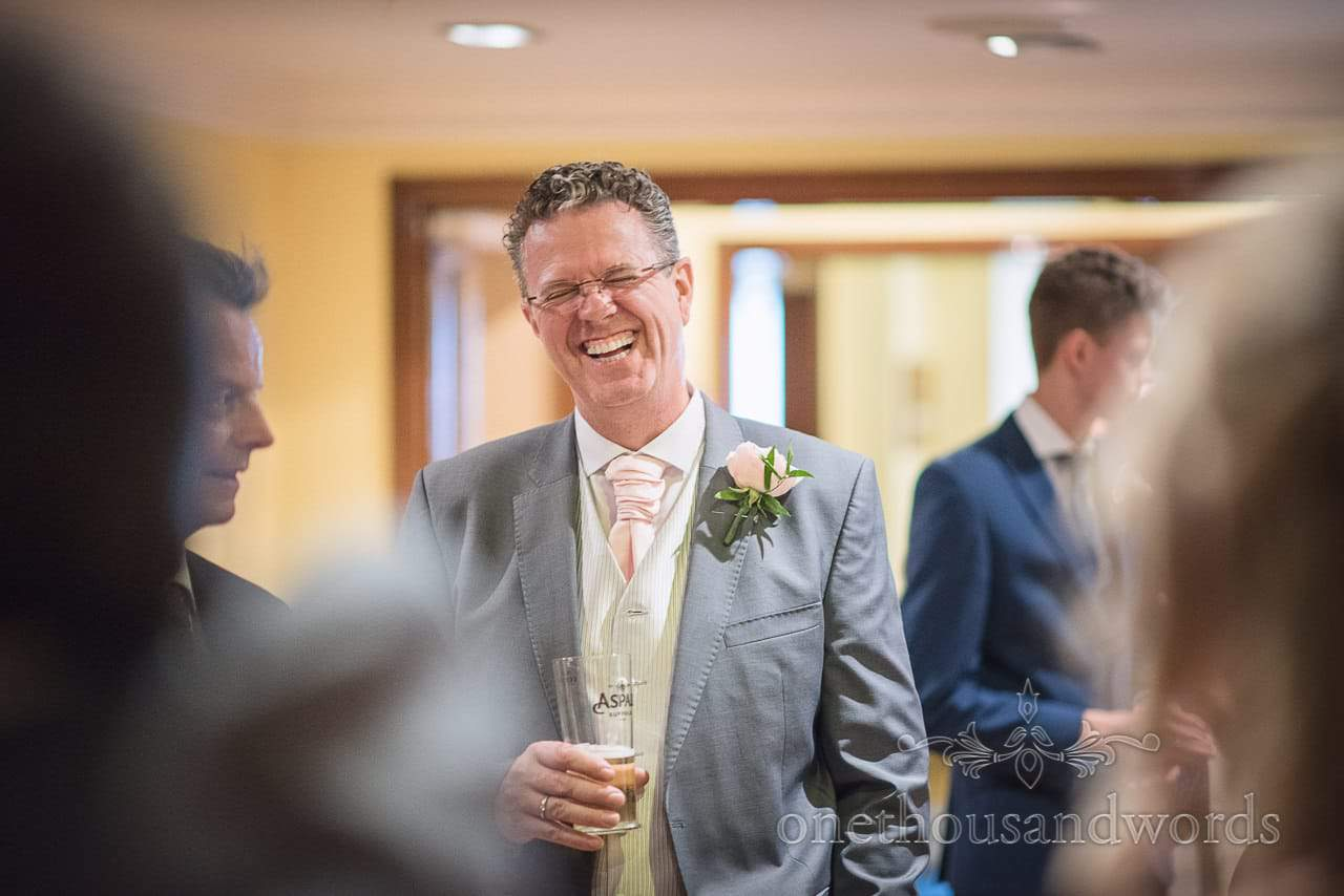 Wedding guest laughing during wedding line up at Bournemouth Hotel wedding