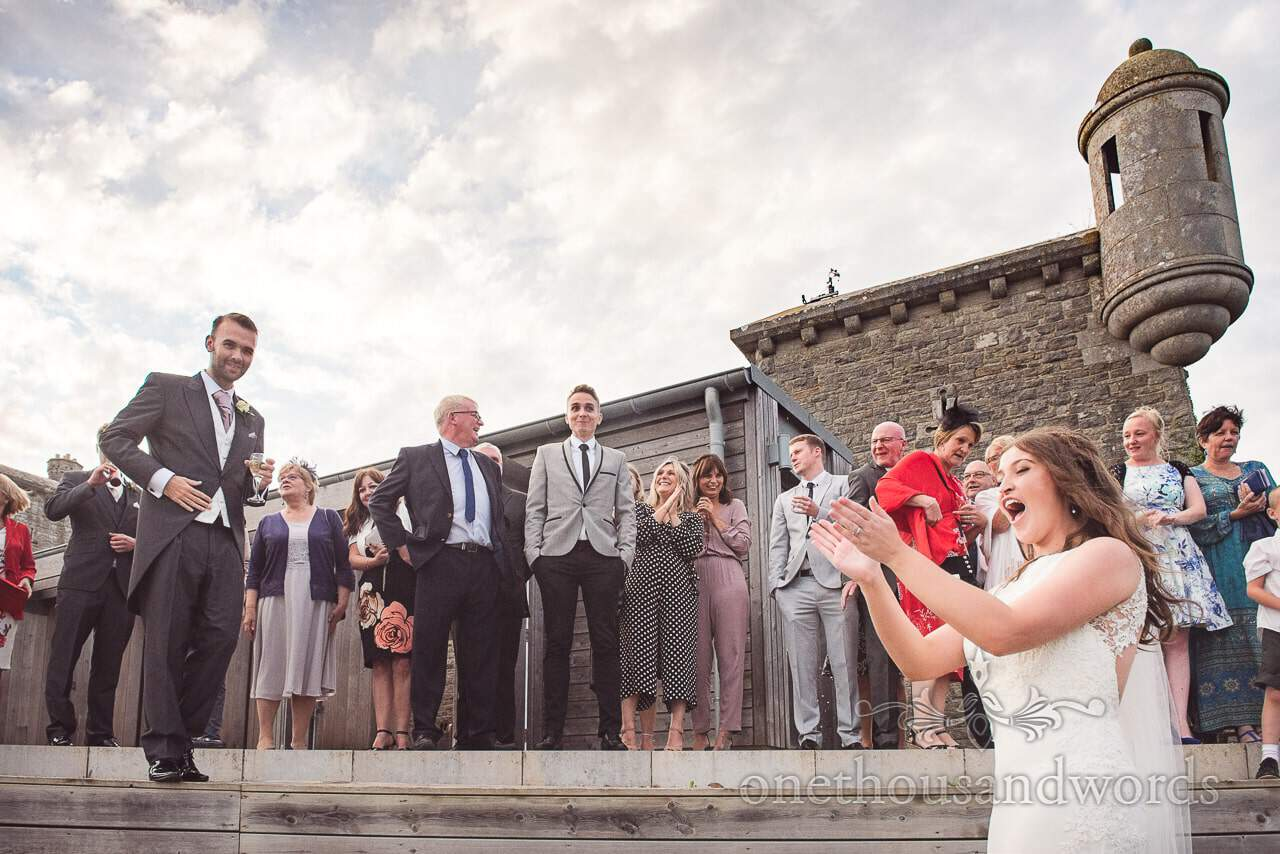 Wedding guest reacts to girlfriend catching bride's bouquet at Durlston Castle Wedding