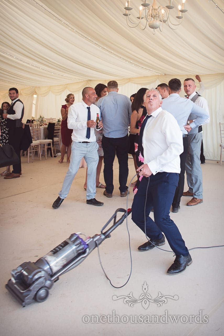 Wedding guest with a vacuum cleaner at Purbeck Valley wedding photographs