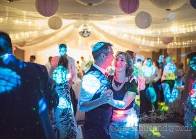 Wedding guests dance under Chinese lanterns at Bournemouth Marriot wedding venue