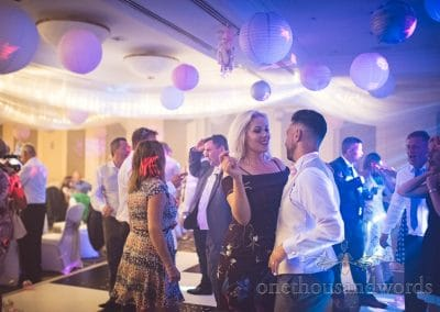 Wedding guests dance under disco lights at Bournemouth Highcliff Marriott wedding