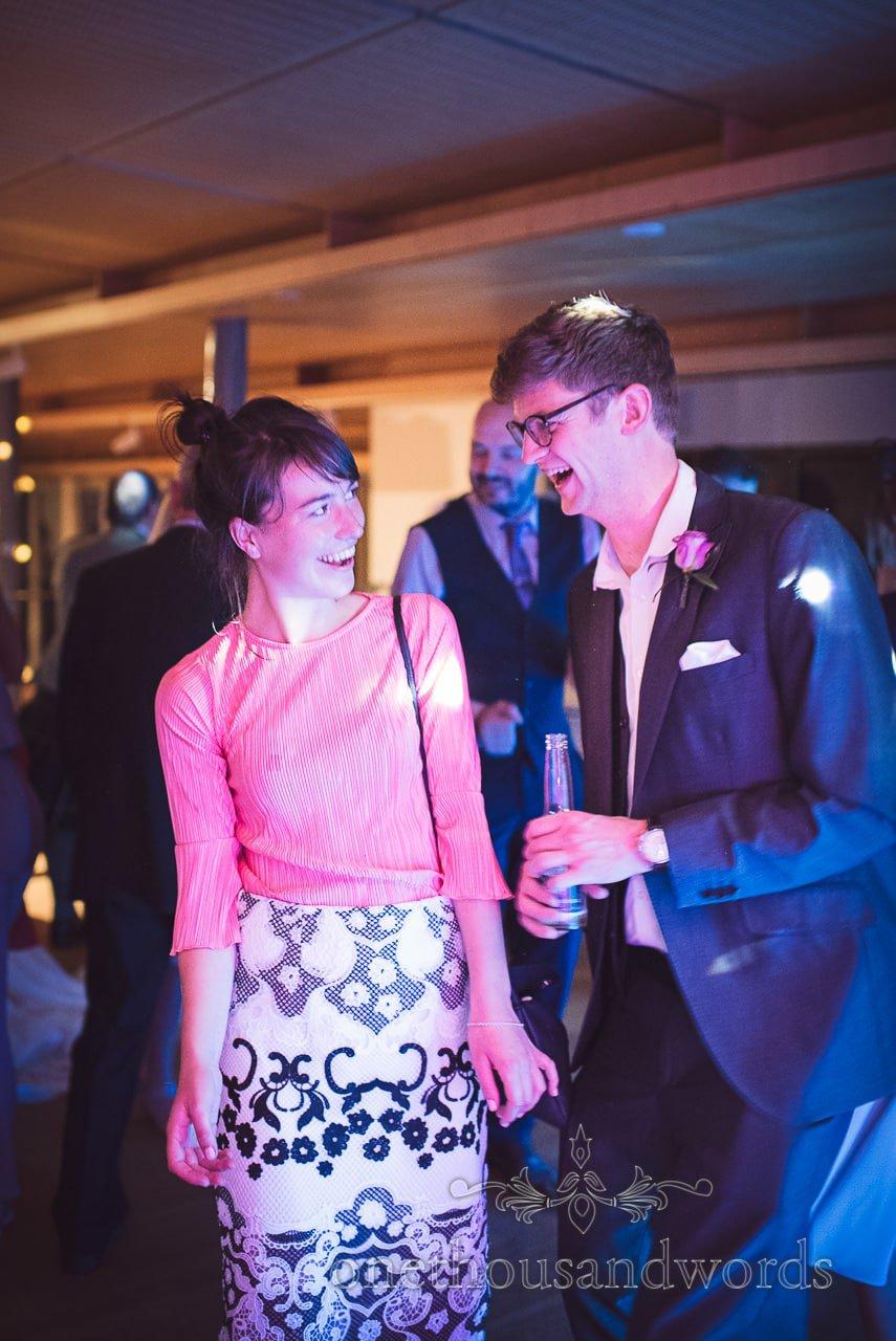 Wedding guests dancing under blue disco lights at Durlston Castle Wedding