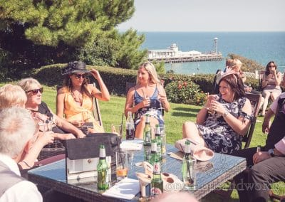 Wedding guests drinks reception overlooking Bournemouth pier at Highcliffe Marriott