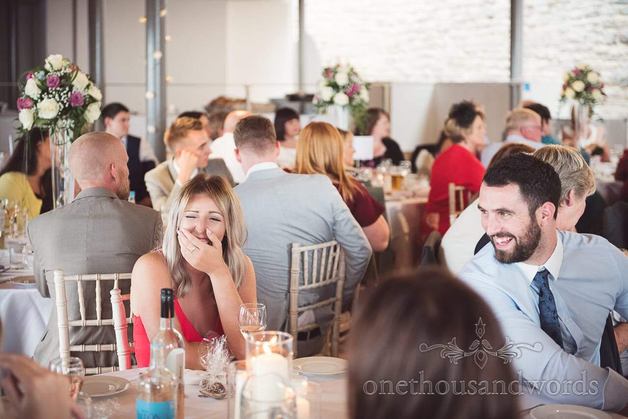 Wedding guests laughing at speeches at Durlston Castle Wedding venue in Dorset