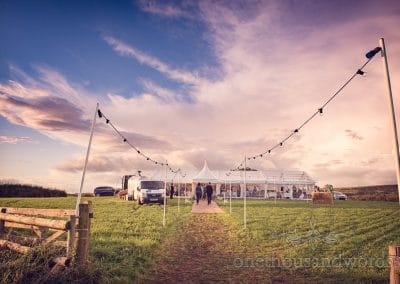 Wedding marquee and dramatic sky at Purbeck Valley Farm wedding photographs
