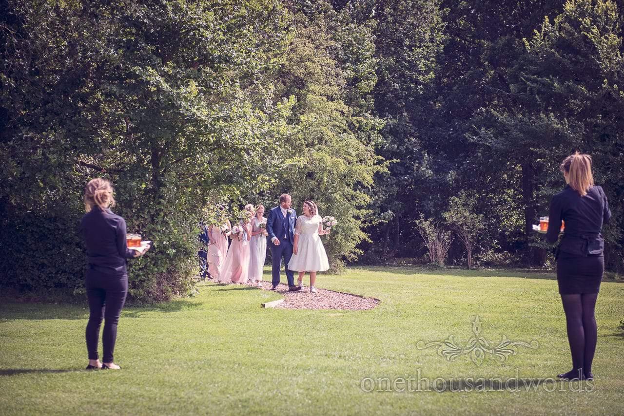 Wedding party emerge from the woodland ceremony at Coppleridge Inn Wedding