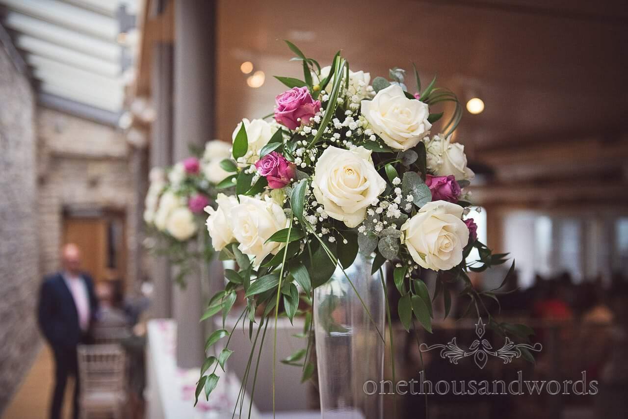 White and purple rose bouquet decoration at Durlston Castle Wedding venue