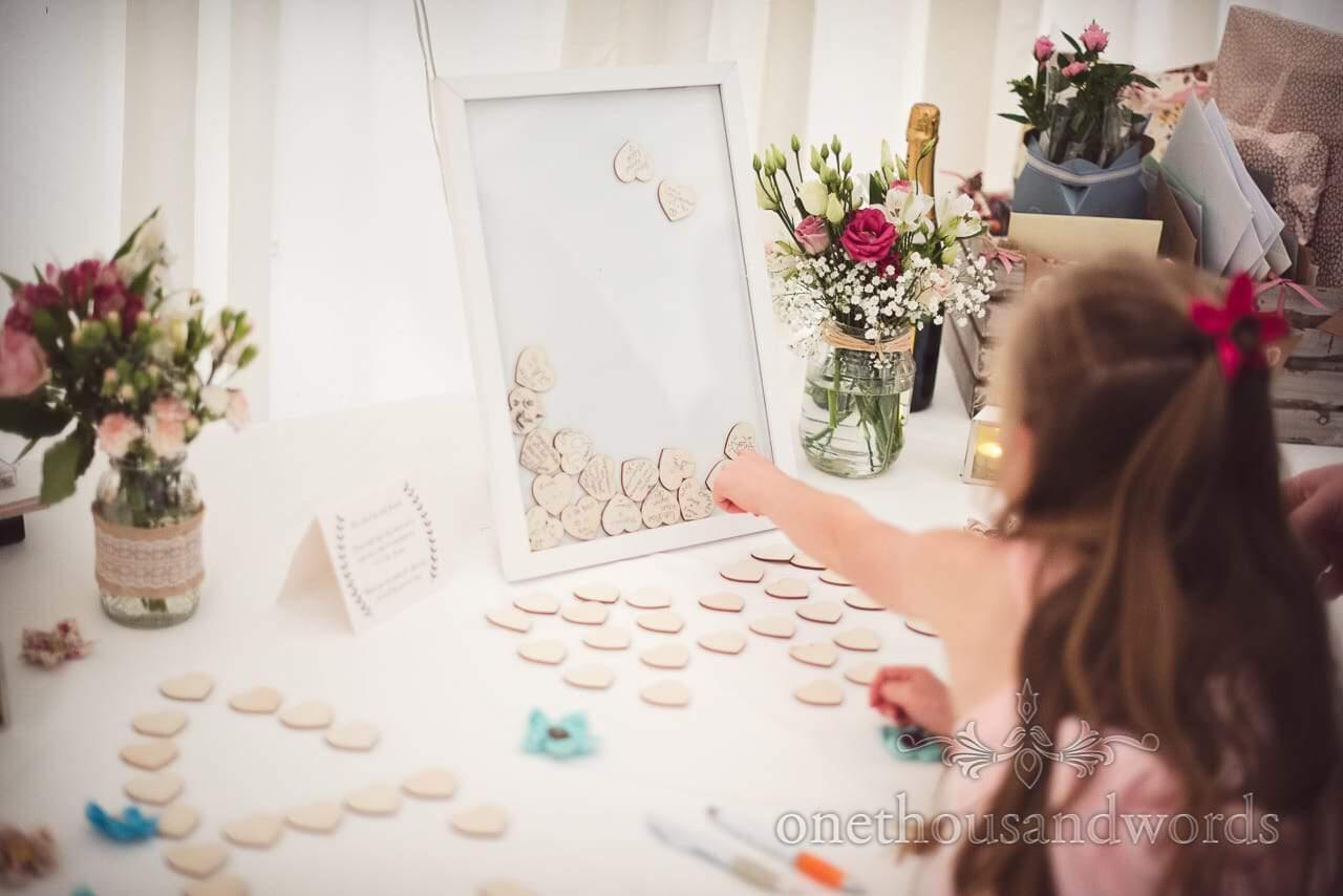 Wooden heart guest signing frame at Coppleridge Inn Wedding Photographs