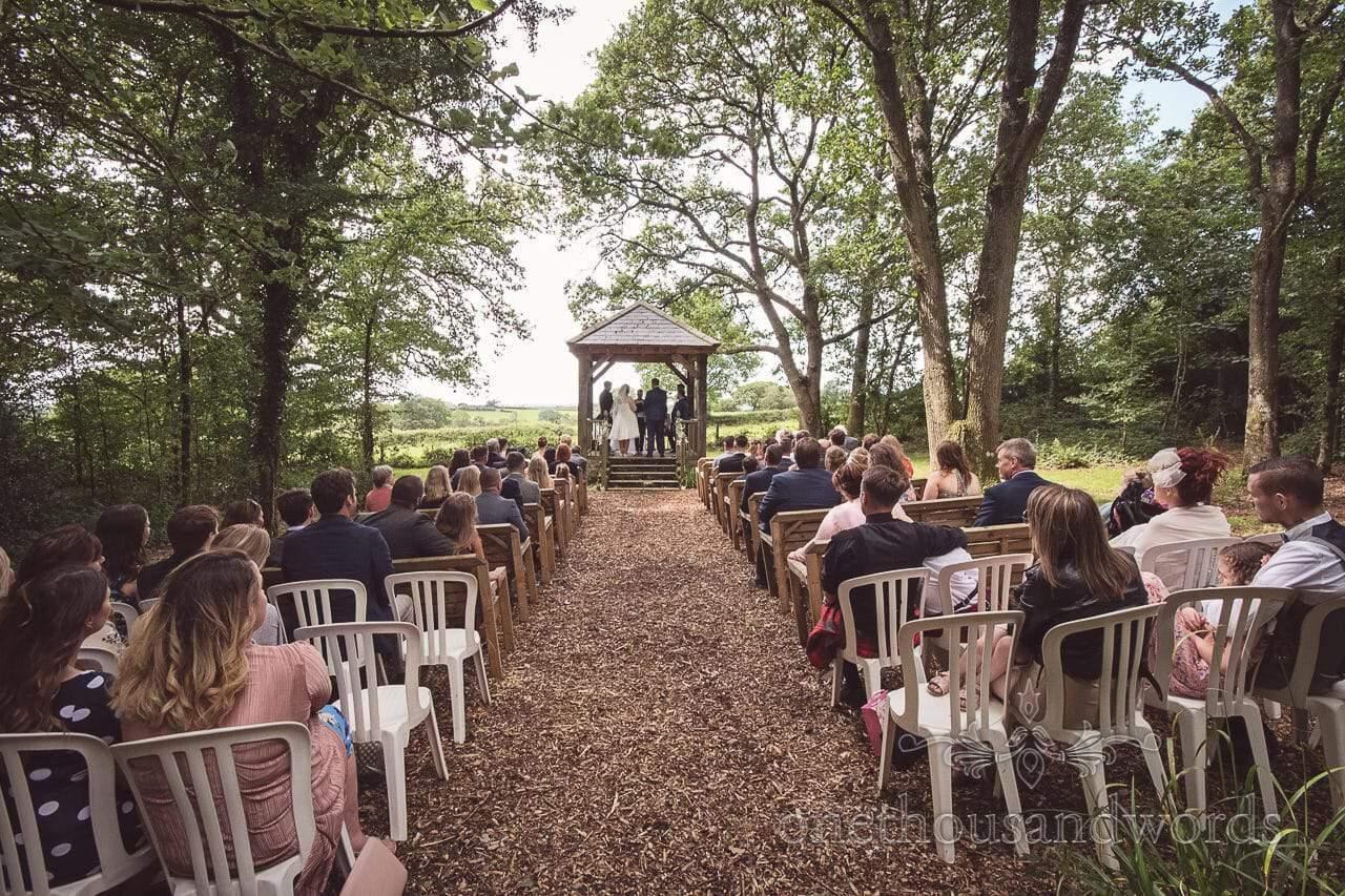 Woodland ceremony with arbour at Coppleridge Inn Wedding