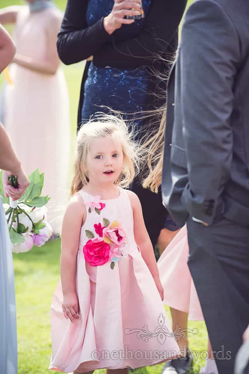 Young guest in pink dress during reception at Coppleridge Inn Wedding Photographs