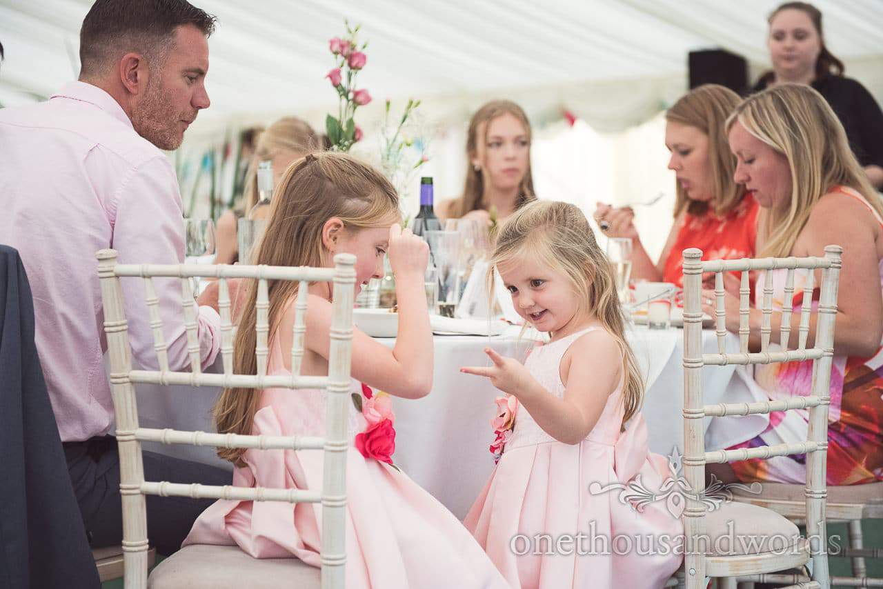 Young guests play rock, paper, scissors at Coppleridge Inn Wedding Photographs