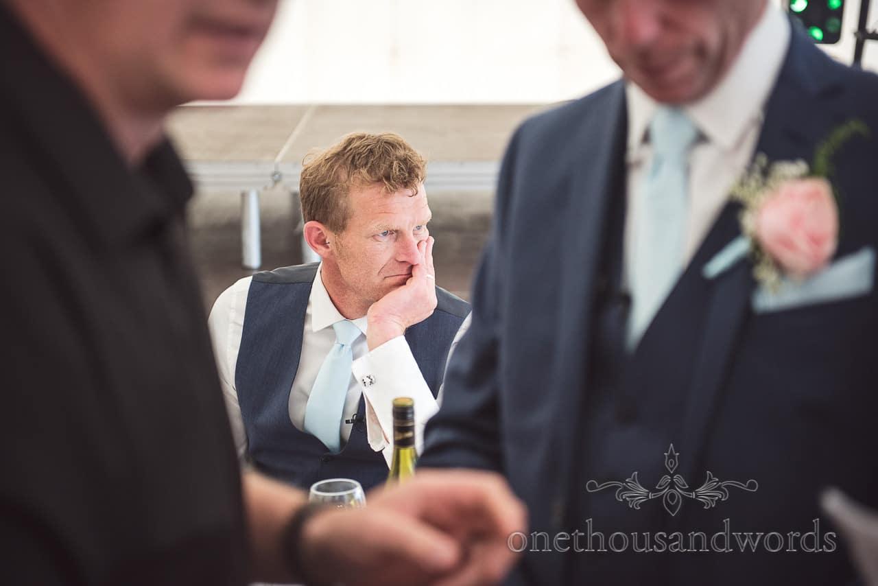 Best man looks nervous before making speech at Dorset Wedding Photographers Wedding