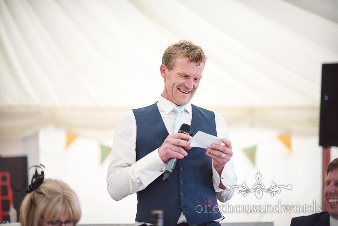 Best man reads from speech cue cards at Dorset Wedding Photographers Wedding