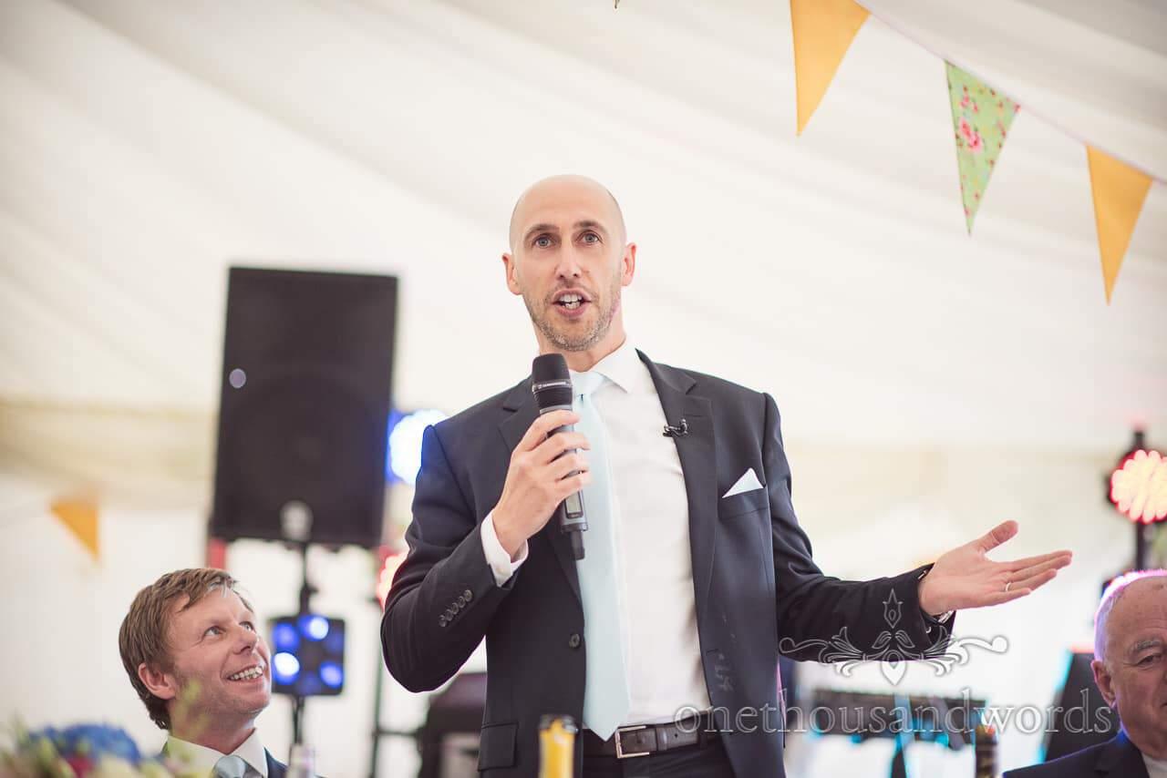 Best man's wedding speech in marquee at Dorset Wedding Photographers Wedding
