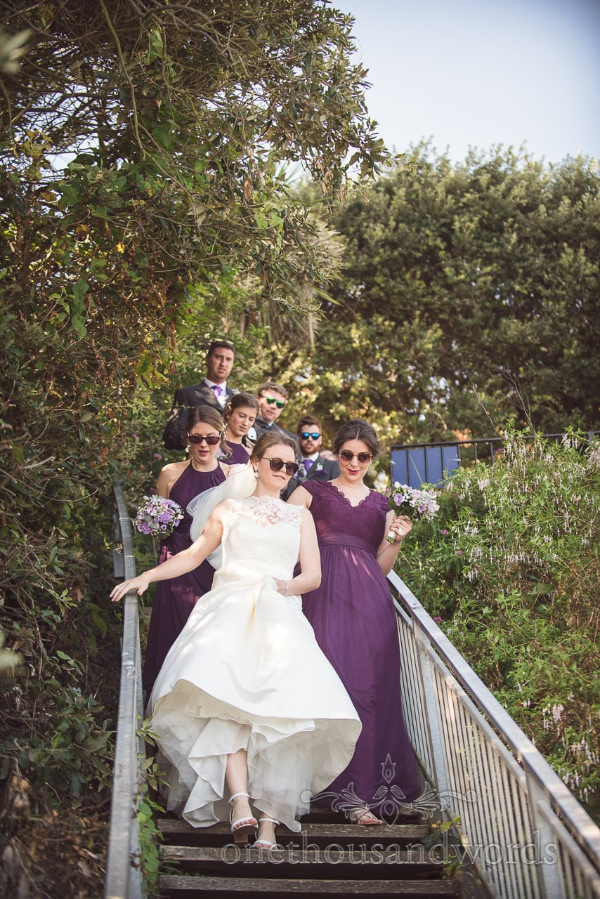 Bridal party descend the staircase to the beach at Grand Hotel Wedding Photographs