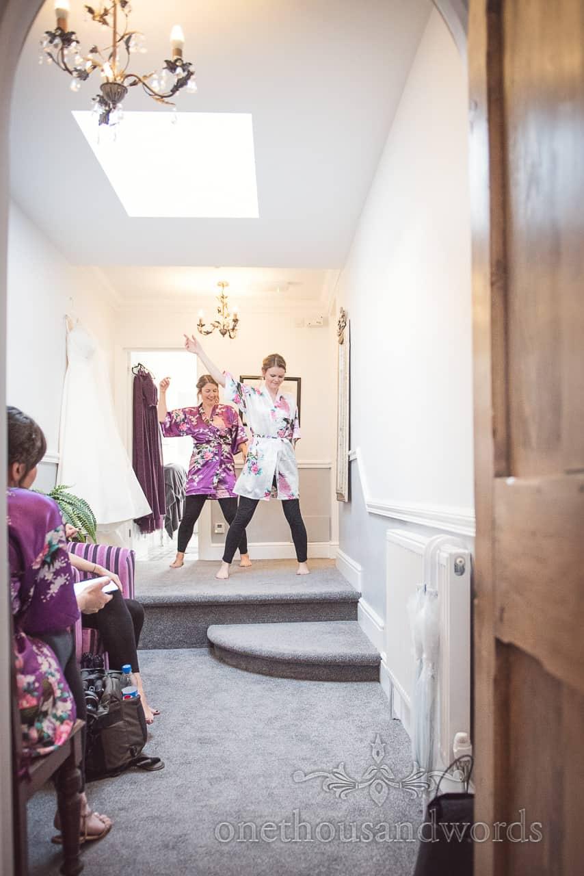 Bride and bridesmaid practice wedding dance routine for Swanage wedding