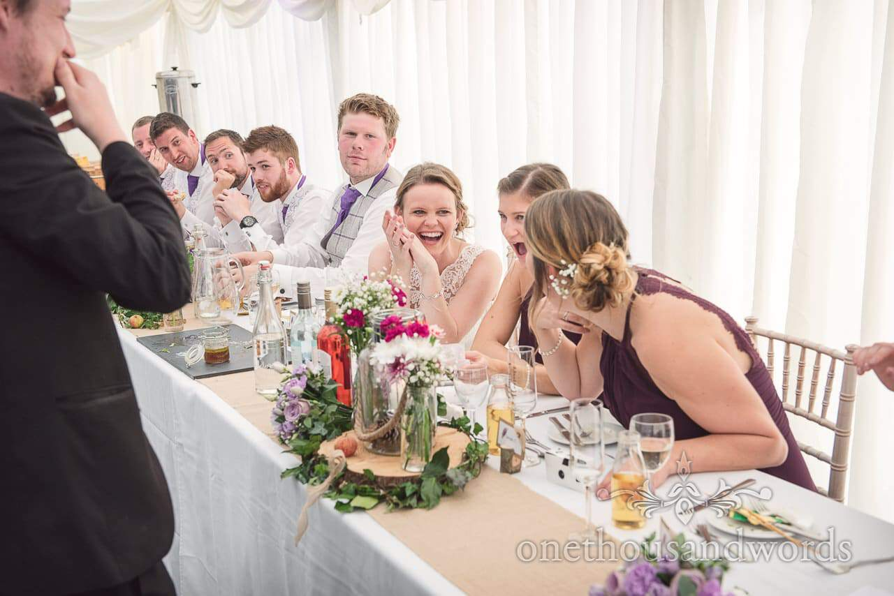 Bride and bridesmaids laugh at Stephen Simmons Wedding magician in Dorset