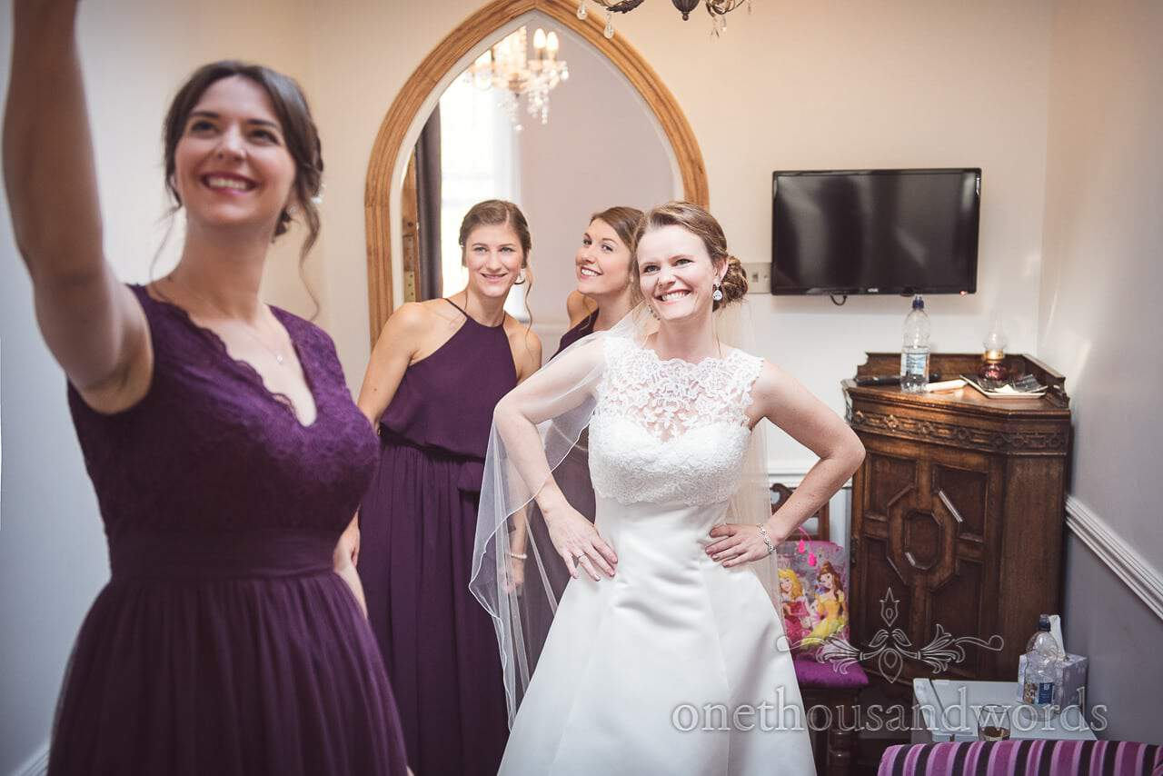 Bride and bridesmaids pose for selfie on morning of Grand Hotel Wedding Photographs