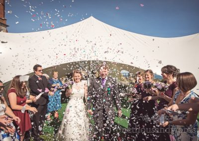 Bride and groom are showered with confetti at Grand Hotel Wedding Photographs